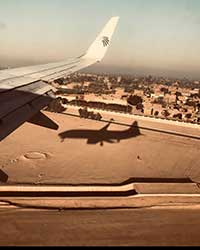 Ariel view of Egypt with shadow in plane aboard a plane