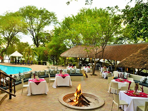 Campfire and pool, Cresta Mowana Safari Resort and Spa