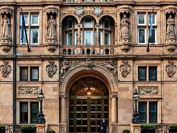 Four carven queens overlook the arched entry to the Kimpton Fitzroy London.