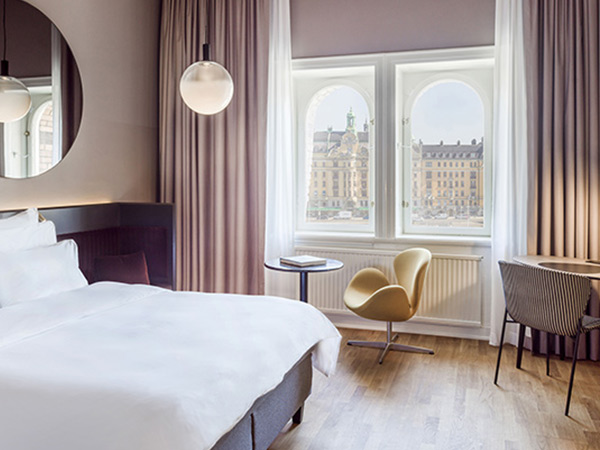 A clean, bright room at the Radisson Strand Hotel, with views of Stockholm.