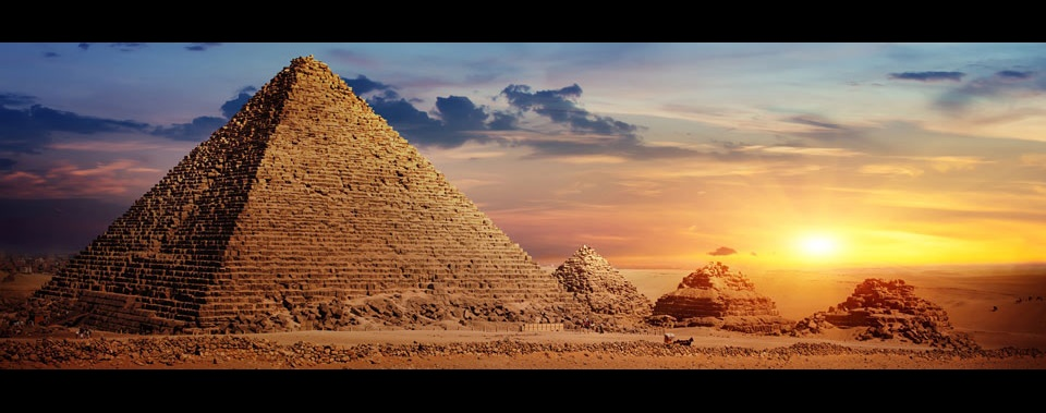 The sun sets behind the pyramids of Giza outside of Cairo, Egypt