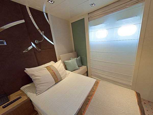 A category C2 guest room on the m/y Variety Voyager
