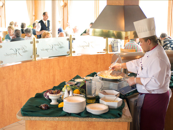 Your dedicated Vantage chef prepares a meal aboard the m/s River Navigator